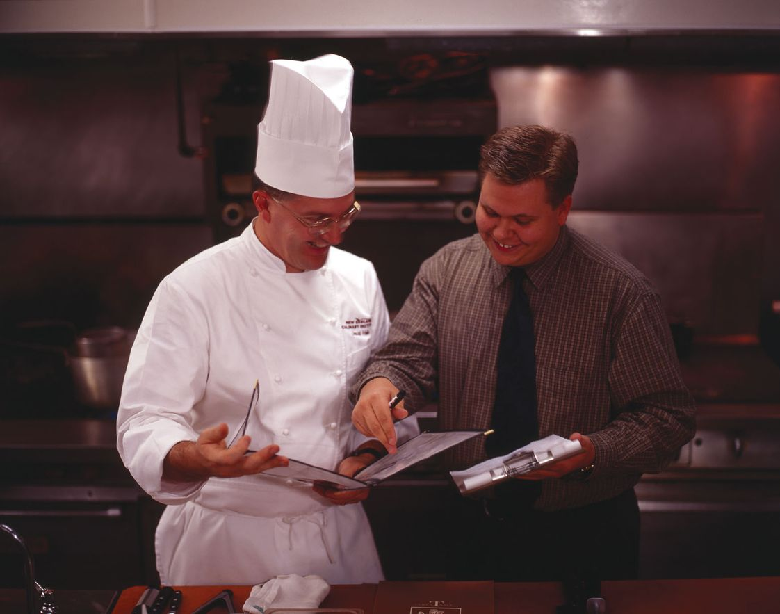 New England Culinary Institute Photo #1 - Reviewing the menu with the chef before service.